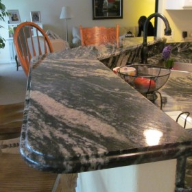 color midnight granite counter and raised bar